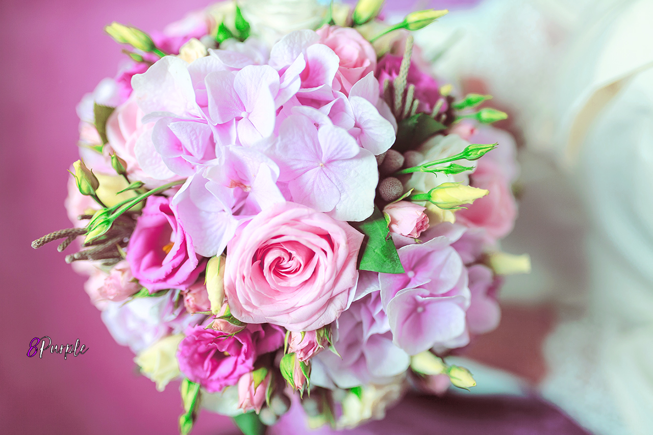 Wedding bouquet of flowers including Red hypericum, Roses, Lilies of the valley, mini Roses, Seeded Eucalyptus, Astilbe, Scabiosa, Pieris, and ivy